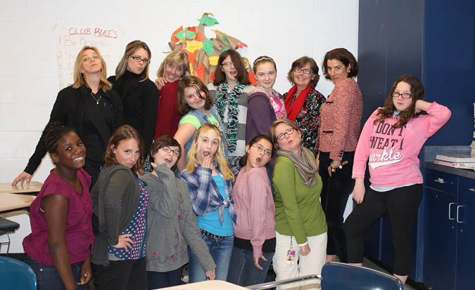 Enka Middle School Students ham it up with United Way's Women's Leadership Council