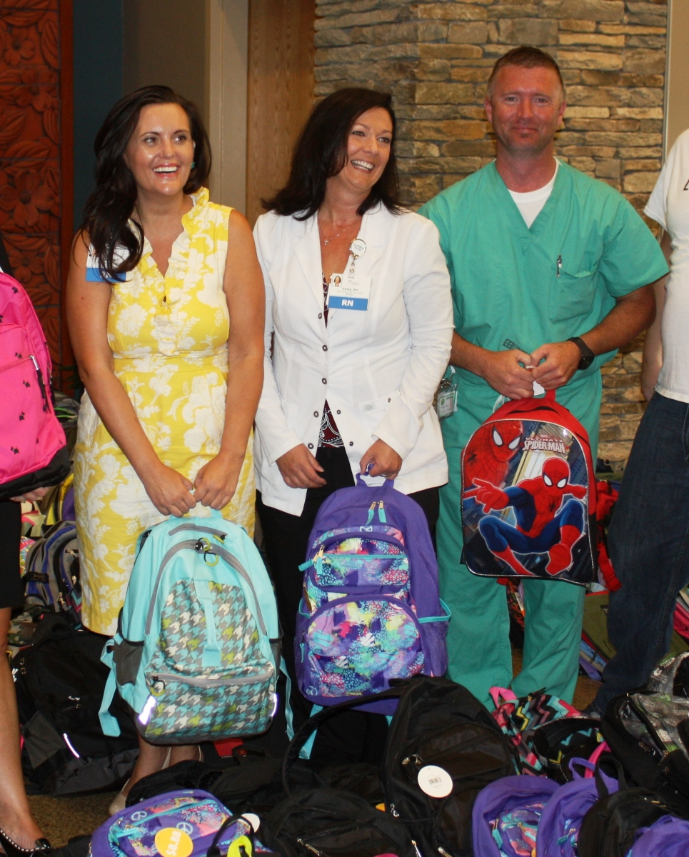 Hospital Workers with Backpacks