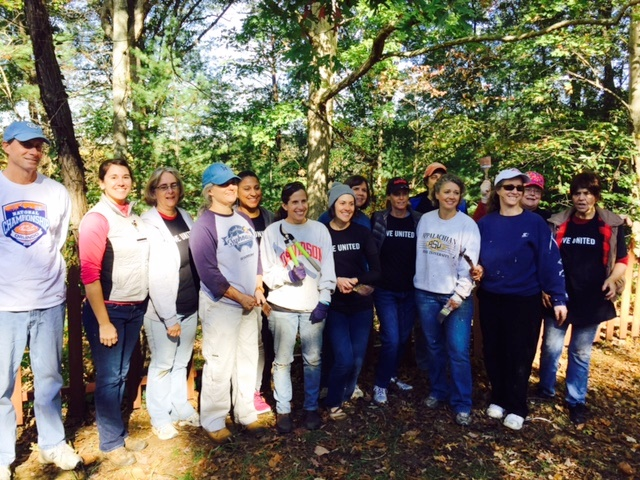 Community Foundation staff helped restore a Koi pond for those served by CarePartners