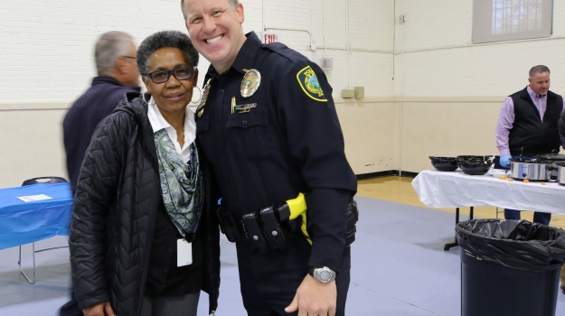 City Manager and UWABC Board Member, Deborah Campbell with officer at Chili Cookoff