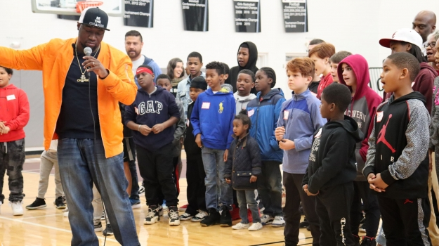 SaulPaul gives the children instructions for the Texas Two Step